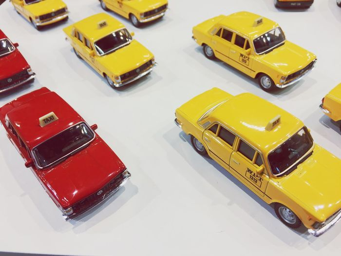 Taxi Praha Red Taxi EyeEm Selects Car Motor Vehicle Mode Of Transportation Transportation Yellow High Angle View Toy Car Taxi Travel Yellow Taxi