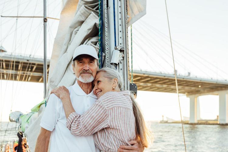 Senior couple travelling on boat