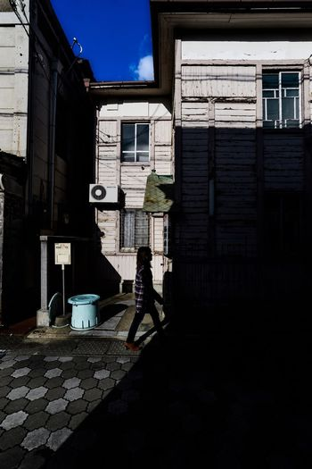 Light and shadow Capture The Moment The Week On EyeEm City Real People Sky Day House Outdoors Built Structure Building Exterior Architecture Walker In Japan Capture The Moment Creative Light And Shadow Light And Shadow Street Light Walking Around The City  One Woman Only Japan Street Old Buildings
