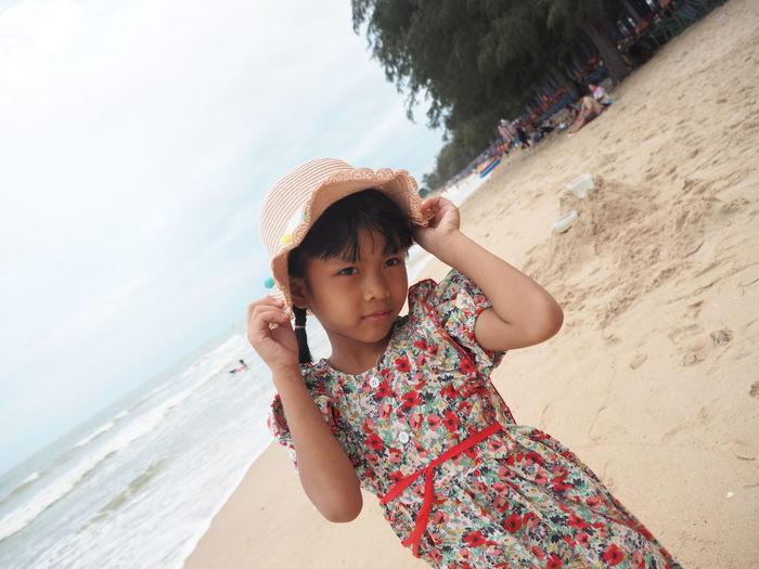 Portrait of boy wearing hat on beach