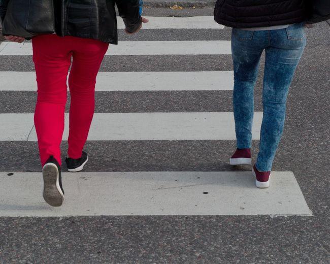 Red and Blue City Road Low Section Human Body Part Body Part Human Leg Street Zebra Crossing Crosswalk Road Marking Women Shoe Walking