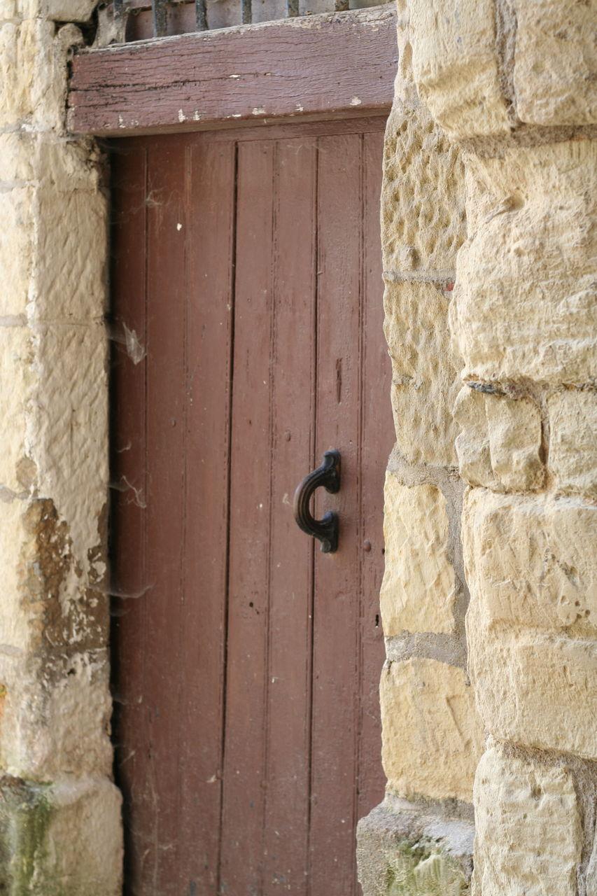 door, outdoors, entrance, built structure, day, door handle, safety, no people, protection, architecture, building exterior, wood - material, close-up, doorway, latch, open door