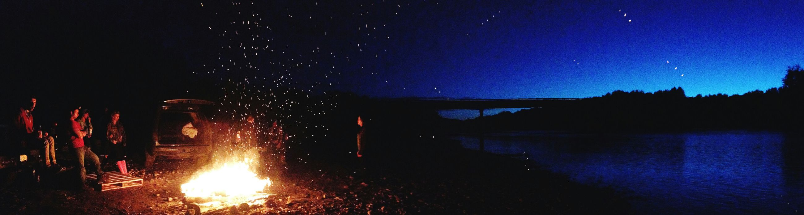 night, illuminated, star - space, star field, scenics, sky, astronomy, glowing, dark, beauty in nature, tranquil scene, star, water, tranquility, long exposure, silhouette, galaxy, nature, idyllic, fire - natural phenomenon
