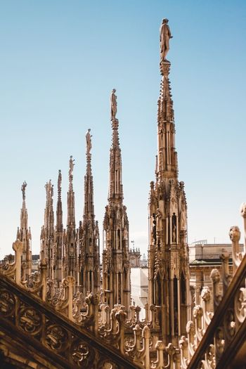 Religion Clear Sky Spirituality Place Of Worship Built Structure Architecture Building Exterior Outdoors Low Angle View No People Sky Travel Destinations Statue Day Sculpture Italy Italy Photos Italy Holidays Milan Milano Milan,Italy Italianstyle Roof Architecture Architectural Column
