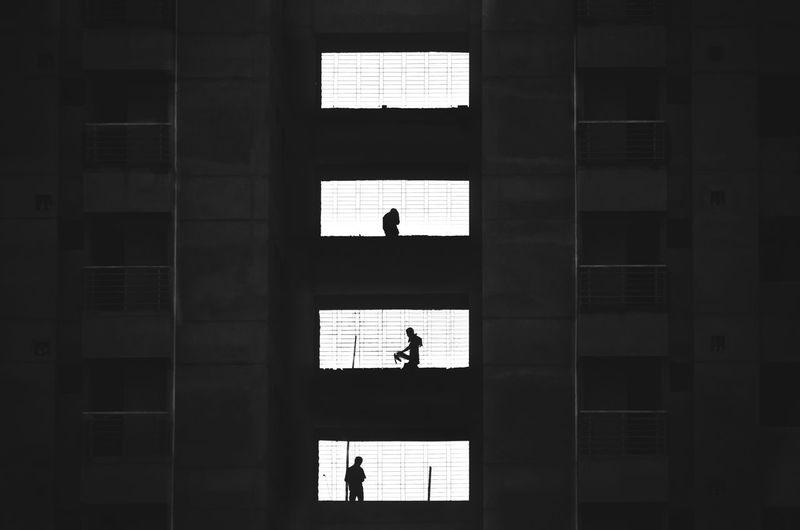 People Shadow On Illuminated Windows