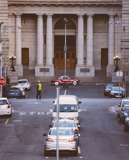 Admire Architectural Column Architecture Building Built Structure City City Life City Street Day Exterior Land Vehicle Leading Lines Mode Of Transport Outdoors Parking Red Car Streetphotography Vintage Cars