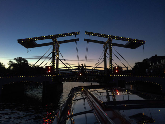 Amsterdam Blue Bridge - Man Made Structure Connection Engineering Holiday Illuminated Nature Netherlands No People Outdoors River Sky Travel Destinations