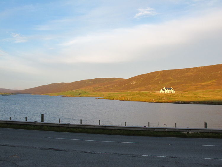 Solitary splendour in golden sunlight Beauty In Nature Cloud - Sky Day Far From The Madding Crowd Hilly Ground In The Golden Fading Sunlight Lone House Mountain Nature On The Other Side Outdoors Remote Shetland Islands Sky Solitary Solitary Moments That House Far Away