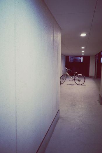 Architecture Wall - Building Feature Indoors  Bicycle Built Structure Transportation Arcade Corridor No People Land Vehicle Mode Of Transportation Parking Lighting Equipment Office Illuminated Ceiling Wall Architectural Column Building Stationary