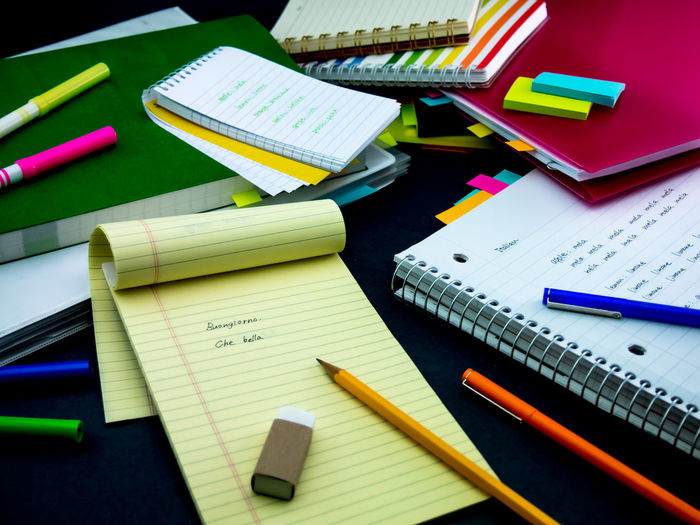 High angle view of note pad with pencil and eraser on desk