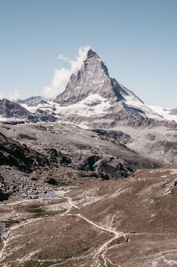 Mountain Sky Beauty In Nature Scenics - Nature Environment Landscape Cold Temperature Snow Tranquil Scene Non-urban Scene Tranquility Day Snowcapped Mountain Nature Mountain Range Idyllic Outdoors Mountain Peak Hiking Hiking Trail Lake Matterhorn  Matterhorn Zermatt