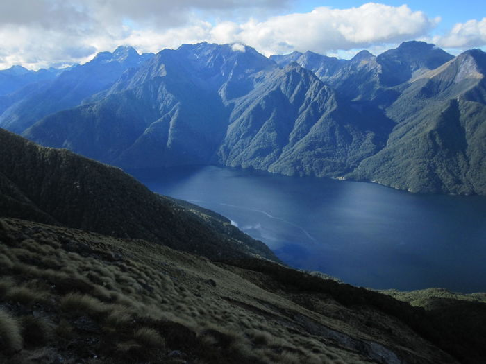 Mountain Water Beauty In Nature Sky Scenics - Nature Mountain Range Environment Landscape Nature Tranquil Scene Cloud - Sky Lake Tranquility No People Winter Cold Temperature Snow Day Outdoors Mountain Peak Snowcapped Mountain Formation New Zealand Kepler Track