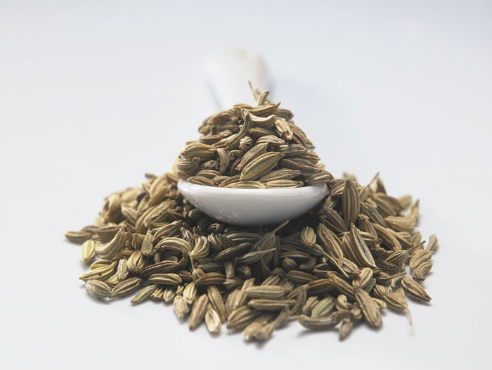 heap of cumin seeds on the white background Container Natural Seed Aroma Bowl Close-up Condiment Cumin Food Food And Drink Fragrance Freshness Ground - Culinary Healthy Eating Heap Indoors  Ingredient No People Pile Raw Food Seasoning Spice Still Life Studio Shot White Background