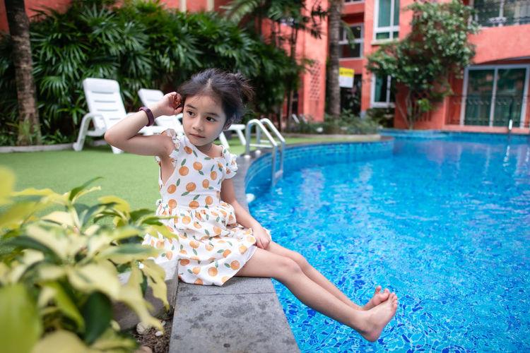 Full length of girl in swimming pool