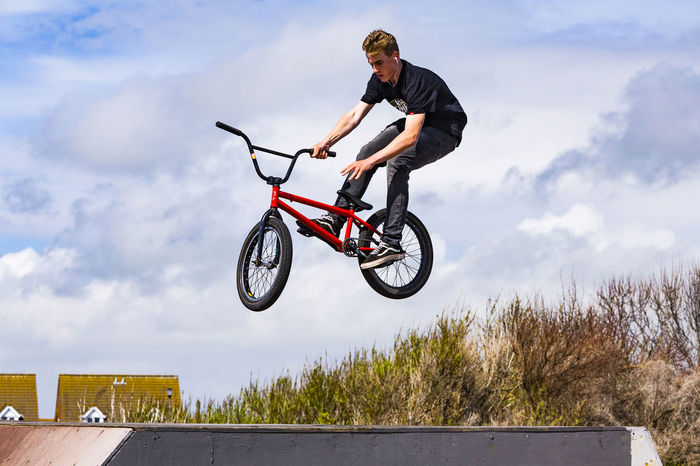 BMX at Sovereign Centre, Eastbourne, East Sussex, England, United Kingdom Bicycle Bmx Cycling Cloud - Sky Cycling Cycling Helmet Day Extreme Sports Full Length Headwear Helmet Leisure Activity Lifestyles Men Mid-air Mode Of Transport Motion One Person Outdoors Real People Riding Skill  Sky Sports Helmet Stunt Transportation