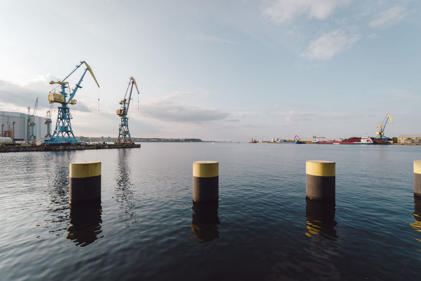 cranes against sky Baltic Sea Cranes Industry Mecklenburg-Vorpommern Wismar Harbor Germany Industrial Landscapes Ocean Water Waterfront Wharf Wismar