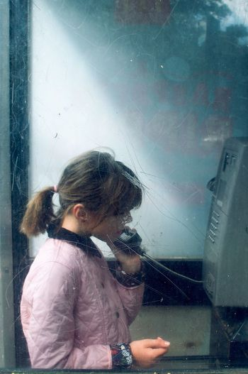 Childhood Day Girls Indoors  One Person People Phonebooth Real People Standing Window Fresh On Market 2017