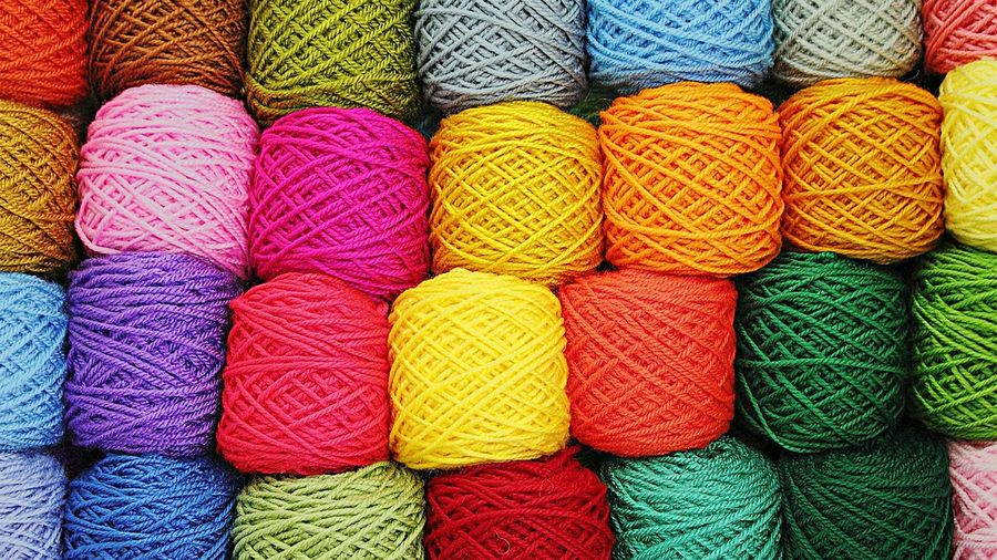 Full frame shot of shot of colorful wools for sale in shop