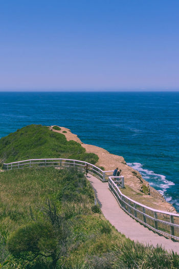 Shortland Esplanade, Newcastle Sea Water Relaxing Enjoying Life Sun Horizon Horizon Over Water Scenics - Nature Sky Land Beach Beauty In Nature Nature Tranquil Scene Plant Day Tranquility High Angle View Blue Clear Sky Outdoors Pathway Esplanade Curvy Travel Destinations