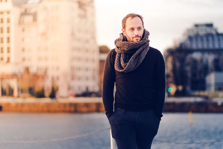 Man wearing scarf standing outdoors