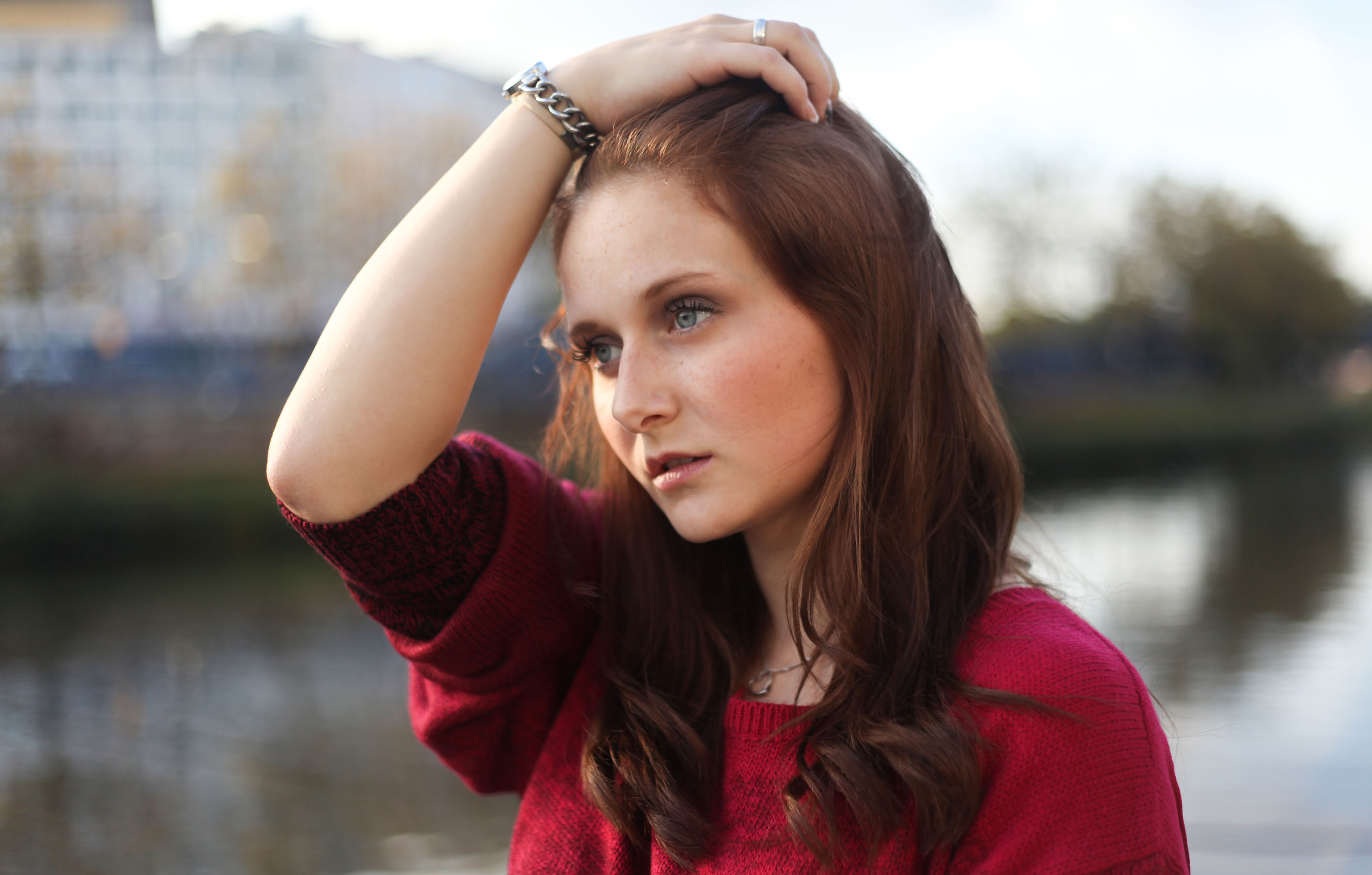 young adult, headshot, worried, one young woman only, young women, one person, focus on foreground, people, women, only women, close-up, one woman only, outdoors, adult, beauty, adults only, portrait, human body part, day