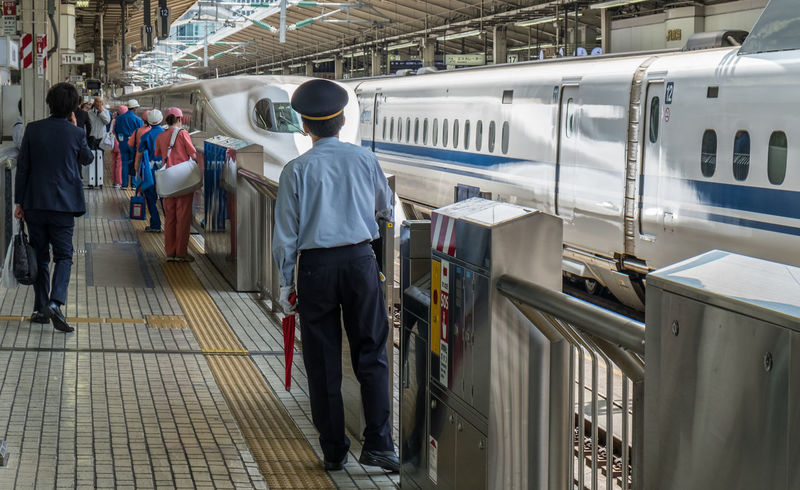 A group of uniform cleaners at a railway station in Japan Bullet Train Cleaner Electric Group Japan Japan Japanese  People Platform Railway Station Train Train Station Transport Transportation Uniform