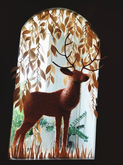 Handicraft of paper deer at the window EyeEm Selects Art And Craft Creativity Representation No People Indoors  Human Representation Sculpture Low Angle View Decoration Craft Illuminated Male Likeness Glass - Material Close-up Statue Pattern Nature Floral Pattern
