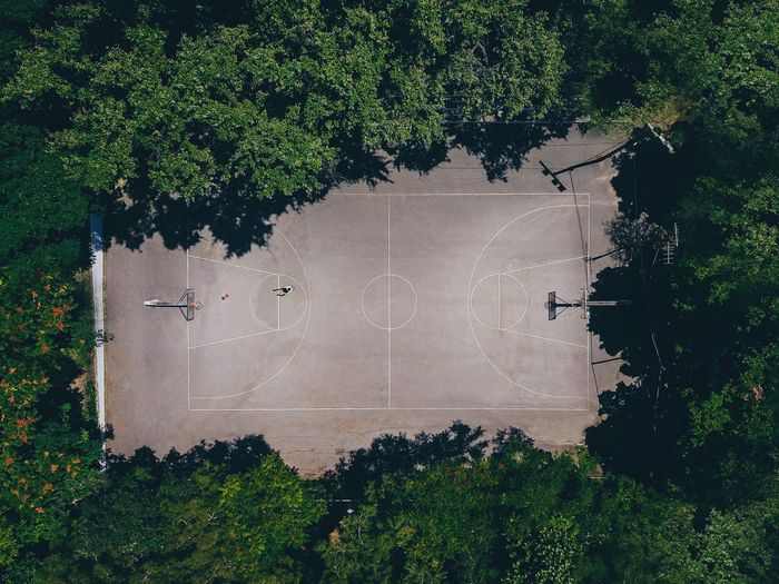 High angle view of basketball court amidst trees