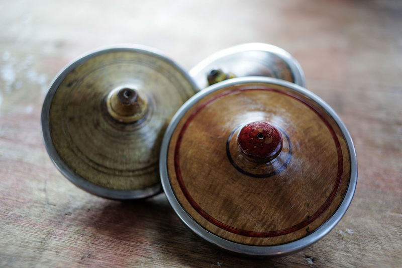 Close-up of spinning tops on wooden table