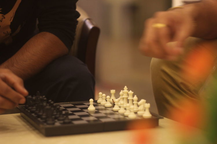 Playing Chess Leisure Games Game Board Game Chess Competition Playing Chess Board Chess Piece Relaxation Leisure Activity Strategy Human Hand Selective Focus Human Body Part Arts Culture And Entertainment Indoors  Hand Two People People Men Human Limb