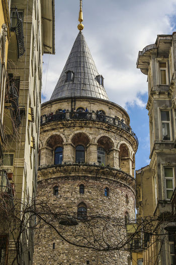 Galata tower amidst buildings against sky