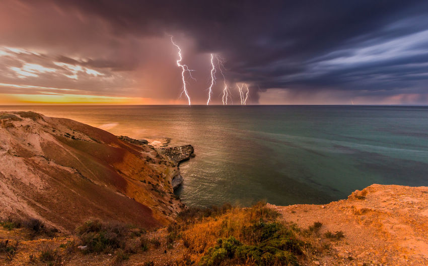 Beauty In Nature Cloud - Sky Coastline Dramatic Sky Landscape Light And Shadow Lightning Nature Outdoors Power Power In Nature Remote Sea Seascape Sky South Australia Storm, Stunning Sunset Tranquility Water