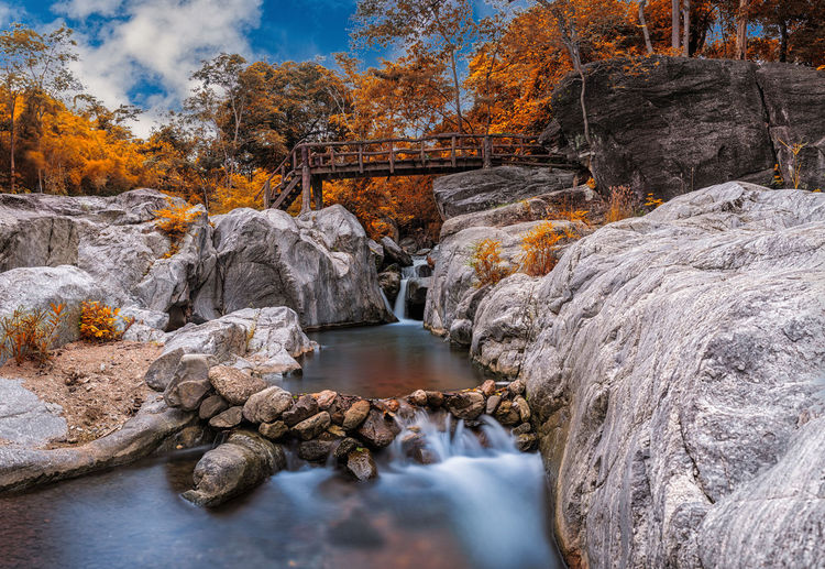 Autumn of waterfalls in Thailand. Japan; Rainforest; Green; Landscape; Autumn; Kanchanaburi; Cool; Beauty In Nature Day Forest Landscape Long Exposure Motion Nature No People Outdoors Rapid River Rock - Object Scenics Sky Tranquil Scene Tranquility Travel Destinations Tree Water Waterfall