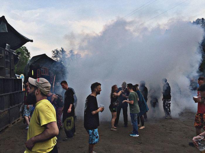 People enjoying in city against sky