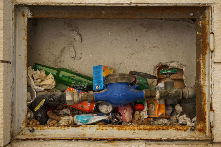 Close-up of garbage in wall