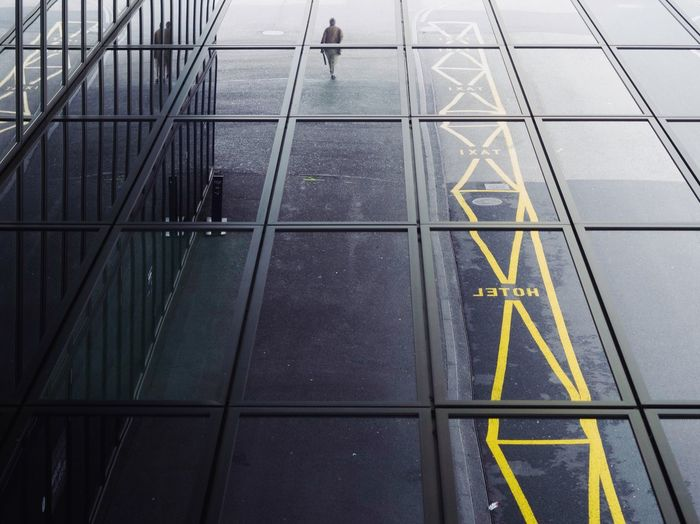 City Business Communication No People Sign Symbol High Angle View Transportation Outdoors Guidance Flooring Arrow Symbol Day Architecture Pattern Shape Road Marking Text Reflection Marking Full Frame