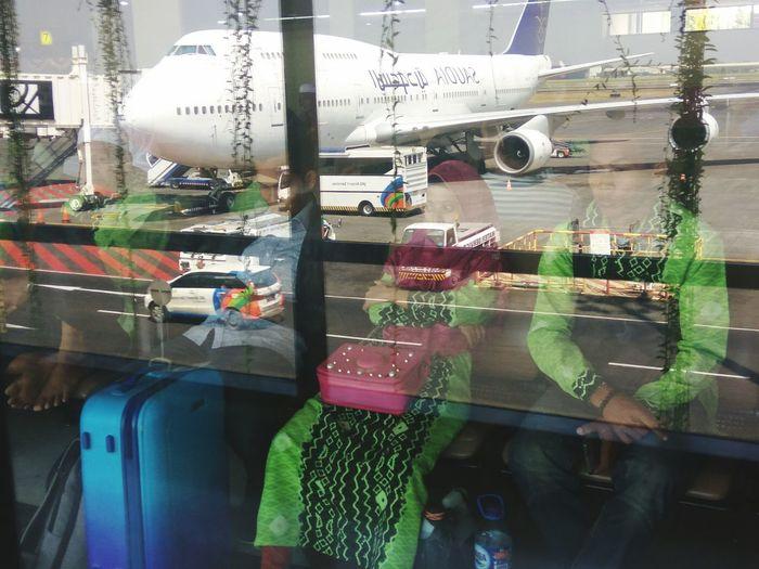 Airplane seen through glass window