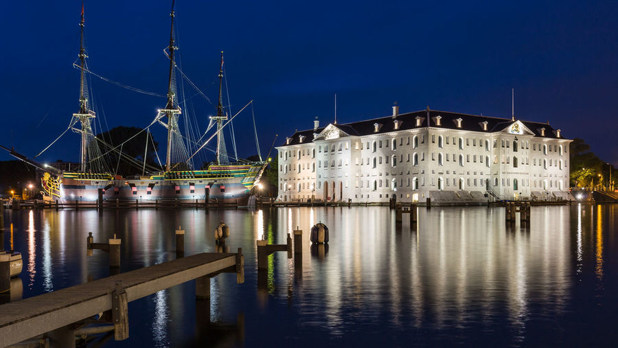 Dutch maritime history Amsterdam Architecture Blue Hour Boat Building Building Exterior Culture Dusk Europe Famous Place Historic Historical Historical Building History Holland Long Exposure Maritime Museum Nautical Vessel Netherlands Scheepvaartmuseum Ship Twilight Water Seeing The Sights