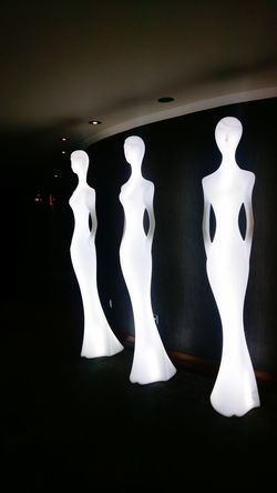 3 laidies Human Representation No People Figurine  Arts Culture And Entertainment Statue Abstract Figures Statues Of Women Bright Lights. Hotel Decor Hotel Interior