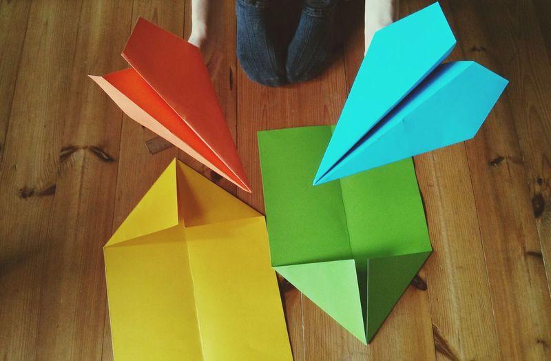 Child making paper aeroplane