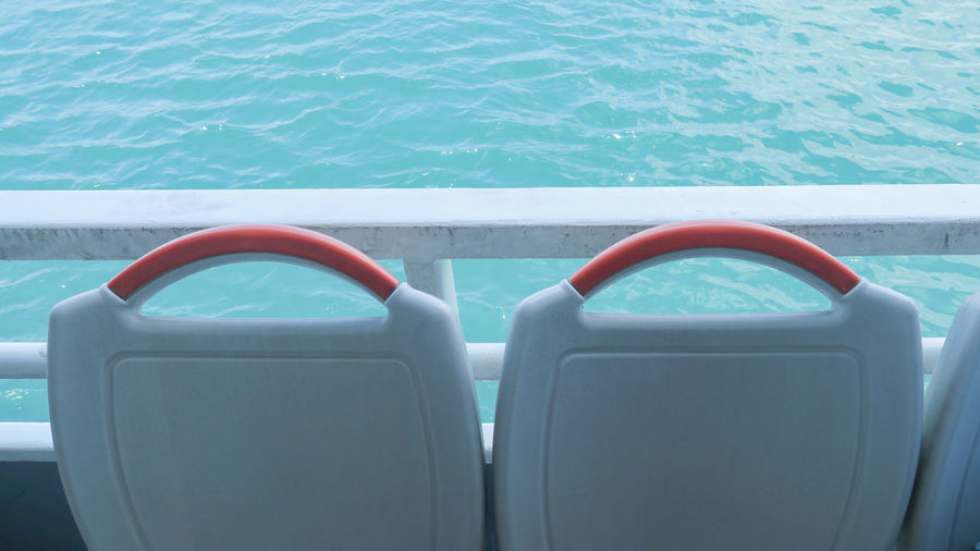 High angle view seats on boat in sea