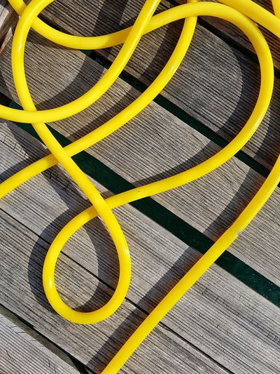 Close-Up Of Yellow Hose On Table