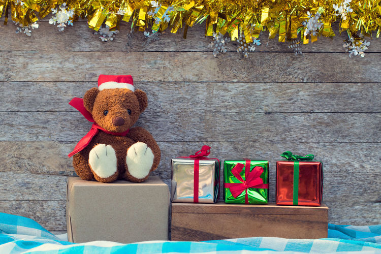 Animal Animal Representation Box Box - Container Brown Container Day Decoration Nature No People Plant Representation Seat Sitting Softness Still Life Stuffed Toy Table Teddy Bear Toy Wood - Material
