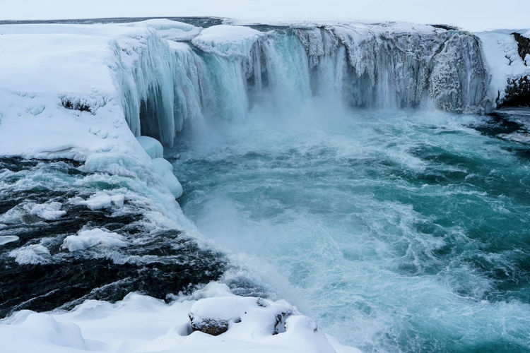 Scenic view of frozen goðafoss