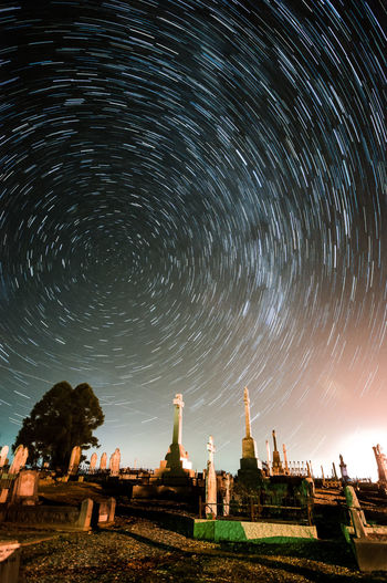 Star trails over the cemetery Cemetery Astronomy Galaxy Star - Space Milky Way Illuminated Place Of Worship Spirituality Religion Cultures Star Trail Graveyard Tombstone Gravestone Place Of Burial Memorial Grave Space And Astronomy Star Field Shrine