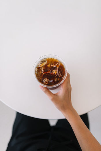 Holding a cup of iced coffee Americano Beverage Close-up Coffee Drink Freshness Holding Human Body Part Human Hand Ice Ice Cube Iced Coffee Minimal Morning Personal Perspective Point Of Virw Refreshment Simple Summer