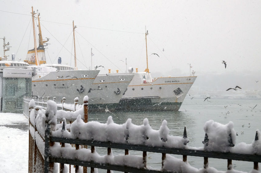 Ferry boats in snowy wintertime at the pier in Istanbul At The Pier Bird Fence With Losts Of Snow Ferry Boats Ferry Boats At The Pier Istanbul Ferry Istanbul Turkey Masses Of Snow Nautical Vessel No People Outdoors Sea Gulls Flying Sky Snow Snow Covered Snowing Travel Destination Istanbul Water Winter Landscape Wintertime