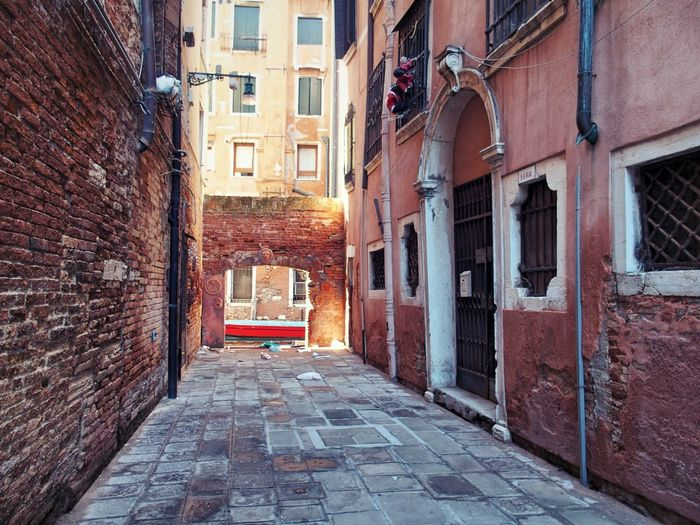 Narrow alley with buildings in background
