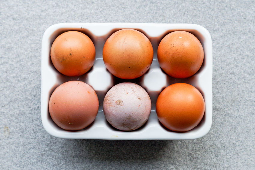 Close-up Day Directly Above Egg Egg Carton Eggcup Eggs Eggshell Food Food And Drink Fragility Freshness Healthy Eating High Angle View Indoors  No People Plate Ready-to-eat Simple Simplicity Still Life Table