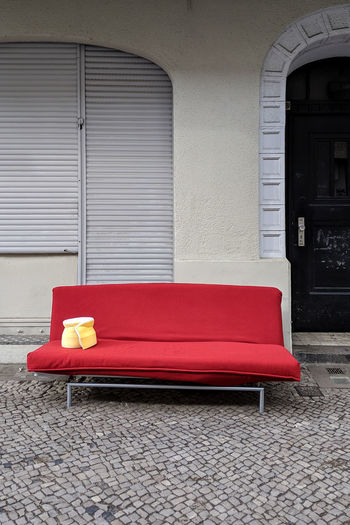 Built Structure Architecture Building Exterior Red No People Furniture Window Seat Day Sofa Empty Wall - Building Feature Outdoors Building Red Color Waste Waste Management